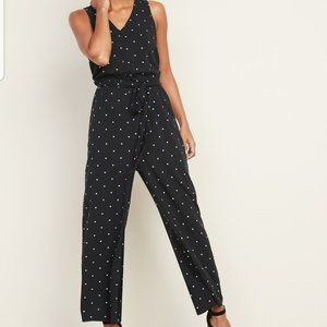 Sleeveless tie-belt jumpsuit black with white dots
